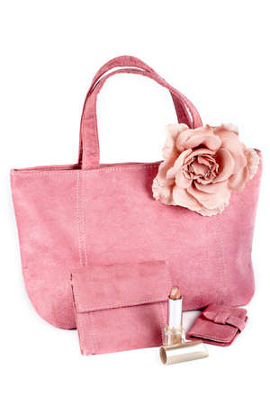 gift spending: Assortment of pink handbags and lipstick on white background