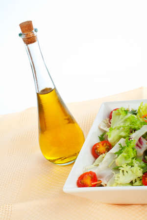 oil bottle: Olive oil bottle and green salad in the bowl Stock Photo