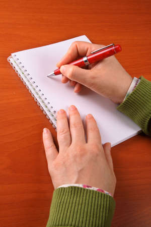 Business woman writing on a blank paper photo