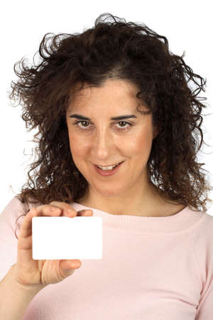 Business woman with credit card over a white background. Credit card, blurred effect photo