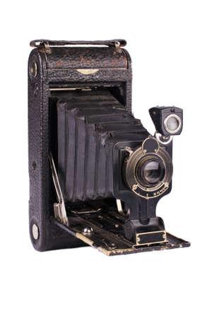 folding camera: Antique folding camera on white background