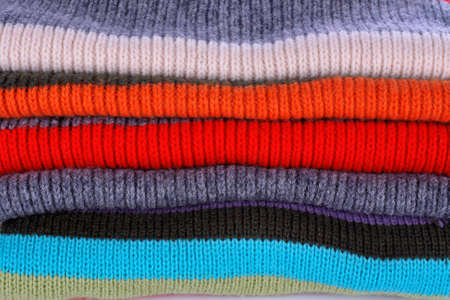 pullovers: Background of several colors pullovers stack