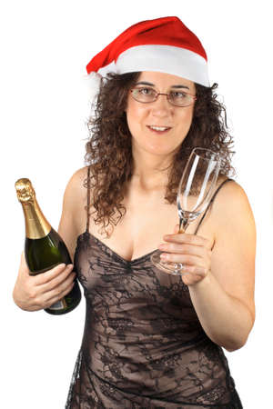 Pretty girl with christmas hat, holding glass and champagne bottle photo