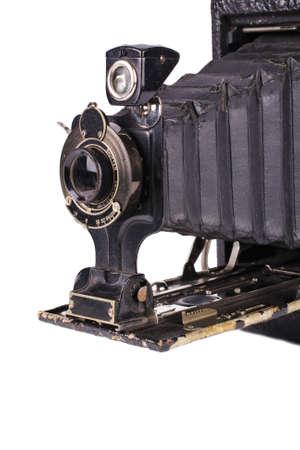 folding camera: Antique folding camera over a white background