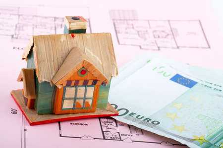 House and euro bills on home plan background photo