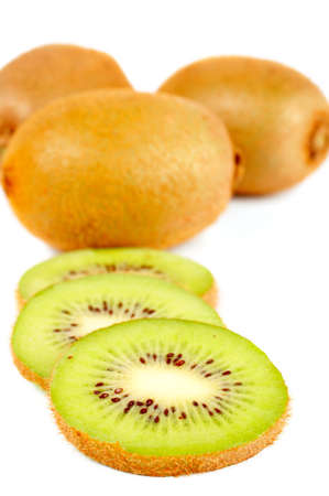 freshest: Three kiwi slices closeup over a white background. Small DOF