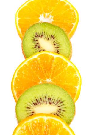 freshest: Oranges and kiwis slices closeup over a white background