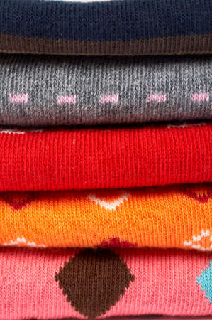 interlink: Background of several colors clothes stack Stock Photo