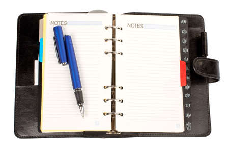 planned: Opened agenda with the pen and notes word written, over a white background