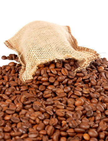 Burlap sack with coffee beans spilling out over a white background photo