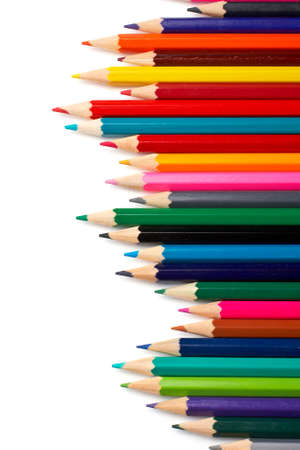 Assortment of coloured pencils with shadow on white background photo