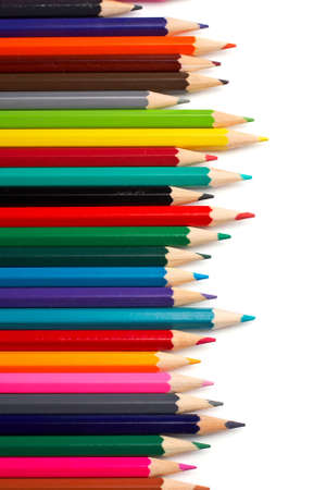 aligned: Assortment of coloured pencils with shadow on white background Stock Photo