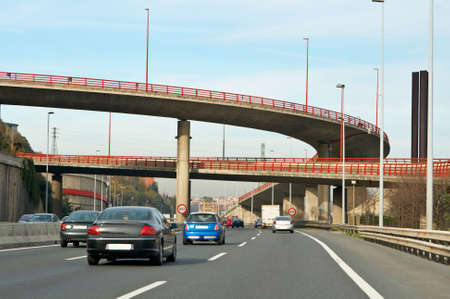 Highway traffic on the cloudy autumn day Stock Photo - 672946