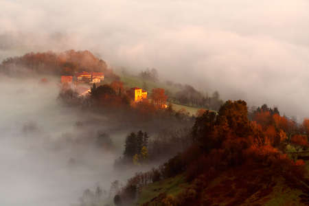 The solitary houses appearing between the fog photo