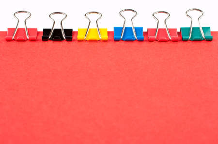 Some colored paper clips binding a red document