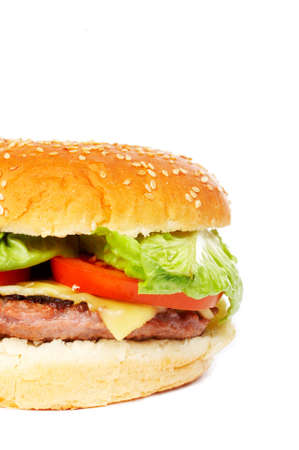 Cheese burger with lettuce and tomato,over a white background Stock Photo - 697319