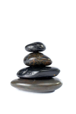 steadiness: Stack of balanced stones with shadow on white background