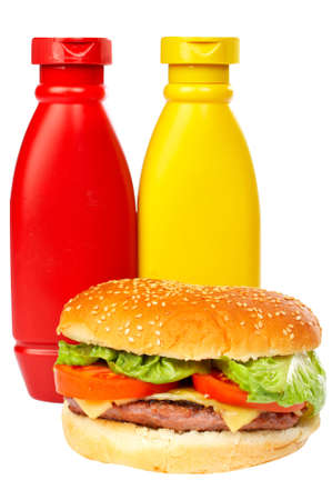 wholegrain mustard: Cheese burger with mustard and ketchup bottles,over a white background