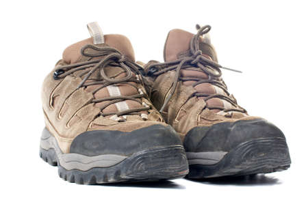 hillwalking: A pair of used hiking boots with shadow over a white background