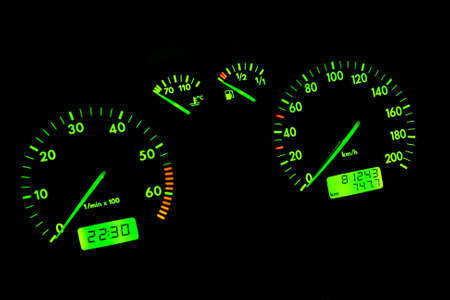 The green neon car dashboard over a black background