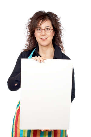 Housewife in apron holding the blank poster on white background photo