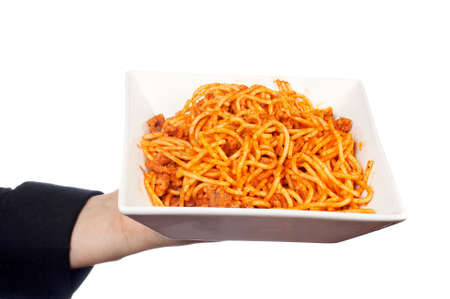 Showing a freshly cooked plate of spaghetti bolognese photo