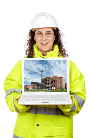Female construction worker showing a building construction on the laptop.Note: on screen image was also shot by me photo