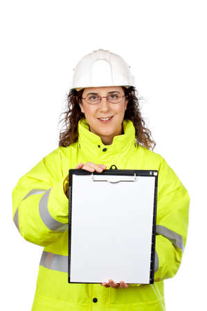 Female construction worker showing a blank sheet, over a white background photo