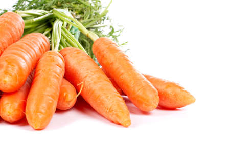 carotene: Bunch of fresh carrots with shadow on white background Stock Photo