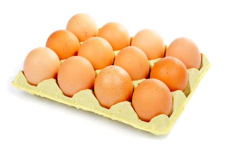 browns: A dozen eggs in a carton container over a white background