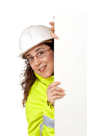 Female construction worker behind the blank banner Stock Photo - 733154