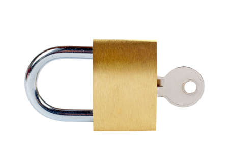 Macro of a locked padlock with the key on it