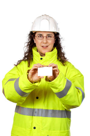 Female construction worker holding one blank card over a white background. Card on focus photo