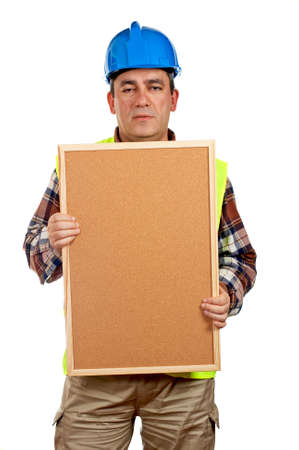 Construction worker with green safety vest holding the empty corkboard on white background photo