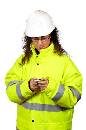 Female construction worker send a SMS, over a white background photo