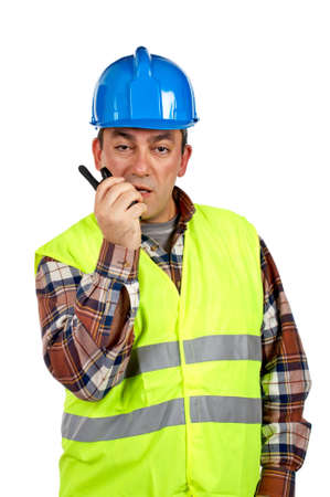walkie: Construction worker with green safety vest talking with a walkie talkie, over a white background Stock Photo
