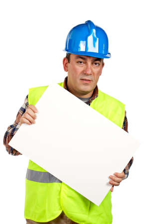 Construction worker with green safety vest holding the blank poster photo