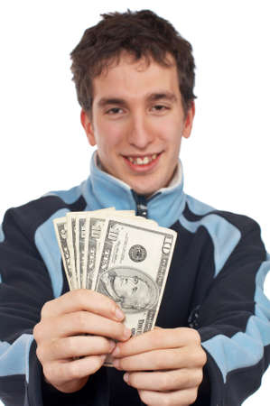 Handsome teenager showing a fan money. Focus on money. photo