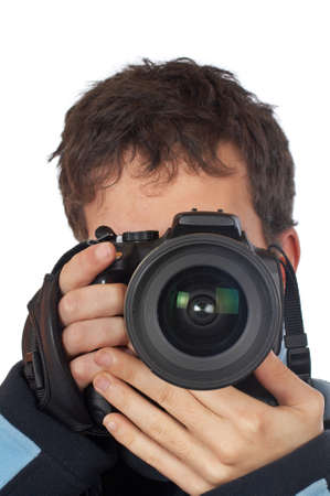 Teenager photographer holding and looking into a camera photo
