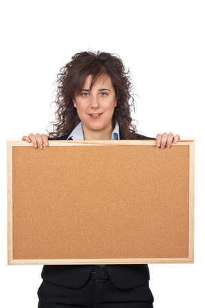 Business woman holding the empty corkboard on white background photo
