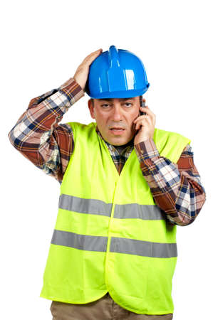 Construction worker with green safety vest talking with cell phone and surprised expression photo