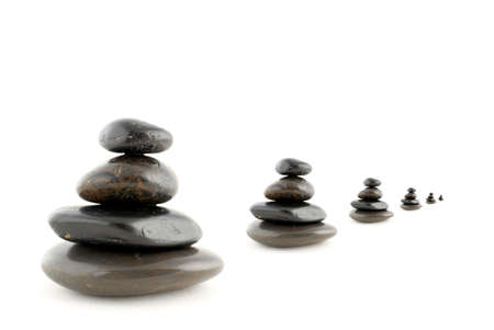 steadiness: Stacks of balanced stones with shadow on white background