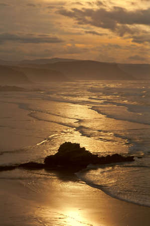 The golden sunrise in the spanish coastline photo