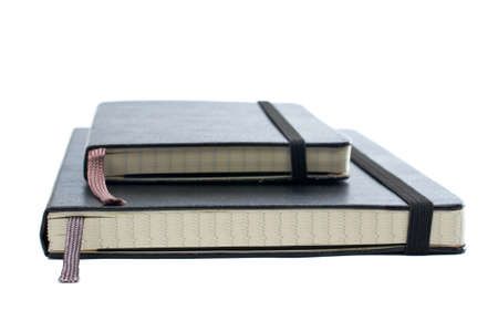 Two blacks notebooks with soft shadow on white background. Small DOF Stock Photo - 781325