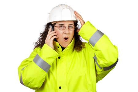 Female construction worker surprised calling with phone photo