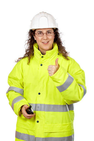 Female construction worker talking with a walkie talkie, over a white background.  Success gesture photo