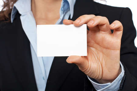 Business woman holding one blank card over a white background. Focus at front