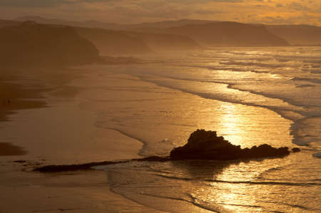 The golden sunrise in the spanish coastline