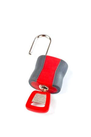 Macro of a unlocked padlock with the key on it. Soft shadow and shallow DOF Stock Photo - 815920