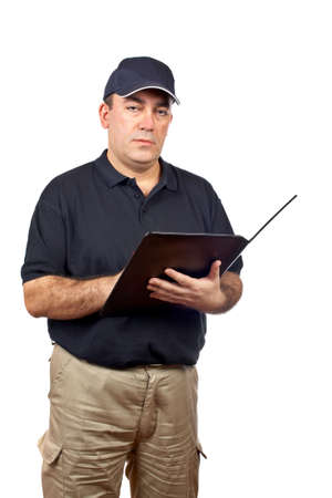 shipped: A serious courier writing on white background Stock Photo